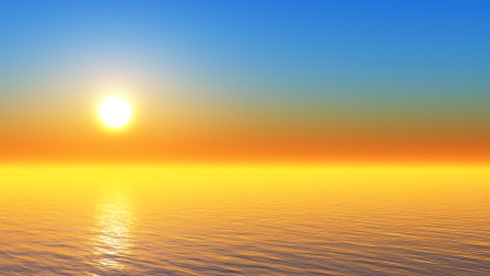 sun in clear sky over tranquil tropical sea