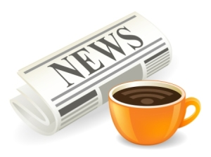 Newspaper and coffee cup on white background